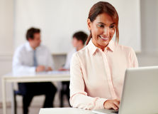 Senior female enterpreneur working with her laptop Stock Photography