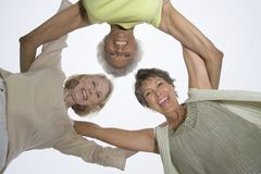 Senior Female Friends In A Huddle Stock Images