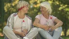 Senior female friends looking camera and showing thumbs up, sport activity. Stock footage stock video