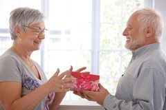Senior female getting present from husband Stock Images