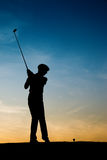 Senior female golf player at sunset Royalty Free Stock Image