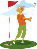 Senior female golfer Stock Photography