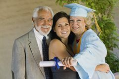 Senior Female Graduate Embracing Family Royalty Free Stock Images