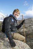 Senior Female Hiker Relaxing On Rock Royalty Free Stock Image