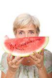 Senior female holding watermelon Stock Images