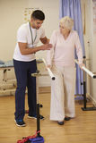 Senior Female Patient Having Physiotherapy In Hospital Royalty Free Stock Images