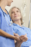 Senior Female Patient Hospital Bed & Woman Doctor Stock Photo
