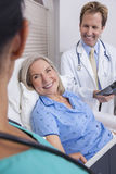 Senior Female Patient With Nurse and Male Doctor Stock Photography
