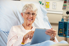 Senior Female Patient Relaxing In Hospital Bed Royalty Free Stock Photography