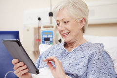 Senior Female Patient Using Digital Tablet In Hospital Bed Royalty Free Stock Photos