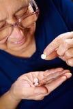 Senior female with pills Royalty Free Stock Photo