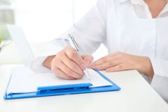 Senior female receptionist. Working in hospital stock images
