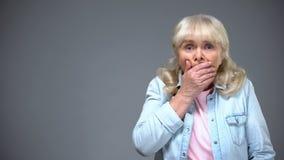 Senior female shocked with bad news, frightened elderly lady, negative emotions. Stock photo royalty free stock photo