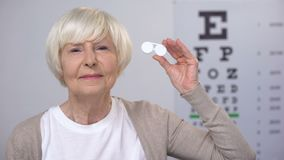 Senior female showing case with contact lenses, preferring new technologies. Stock footage stock footage