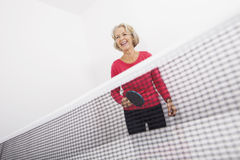 Senior female table tennis player laughing royalty free stock photos