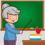 Senior female teacher on blackboard Stock Photos