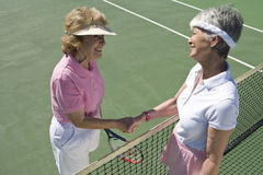 Senior Female Tennis Players Shaking Hands Stock Photos