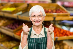 Senior female worker with thumbs up Royalty Free Stock Photo