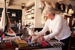 Senior Female Working In Gift Store Royalty Free Stock Image