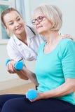 Senior Female Working With Physiotherapist Royalty Free Stock Photo