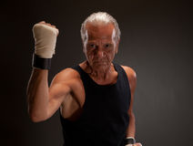 Senior fighter posing with clenched fist Stock Image