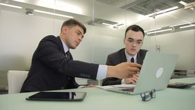 The senior financial analytic helps his junior colleague to create report. stock video