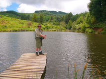 Senior fisherman fly-fishing Royalty Free Stock Photography