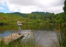 Senior fisherman fly-fishing Stock Image