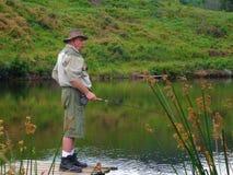 Senior fisherman fly-fishing Stock Images