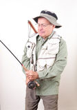 Senior Fisherman Reeling in his Catch Royalty Free Stock Photos