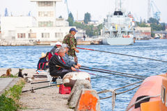 Senior fishermen catch fish from the shore, Varna Royalty Free Stock Photography