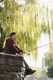 Senior fishing at lake Royalty Free Stock Photography