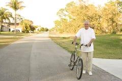 Senior Fitness. Senior man with a bike Royalty Free Stock Photo