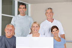 Senior fitness group holding empty Stock Photos