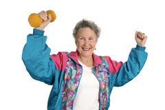 Senior Fitness Success. A senior lady excited over meeting her fitness goals.  Isolated on white Stock Images
