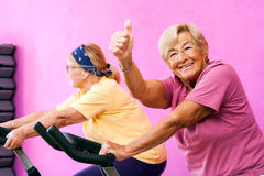 Senior fitness woman doing thumbs up. Royalty Free Stock Image