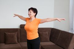 Senior fitness woman exercising at home Stock Photos