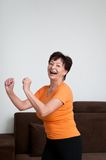 Senior fitness woman exercising at home Stock Image