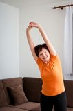Senior fitness woman exercising at home Royalty Free Stock Image