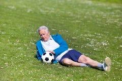 Senior footbal player on grass Stock Photography