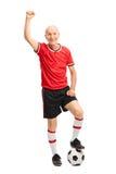 Senior football player celebrating Stock Photography