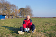 Senior football player on grass Royalty Free Stock Images