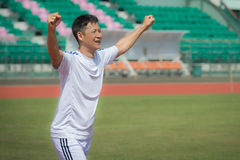 Senior footballer celebrating his new goal. Stock Photos