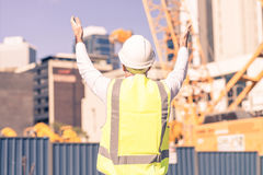 Senior foreman in glasses doing his job at building area on sunn Stock Image