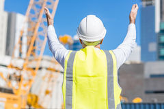 Senior foreman in glasses doing his job at building area on sunny day Stock Photo