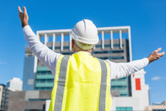 Senior foreman in glasses doing his job at building area on sunny day Royalty Free Stock Image
