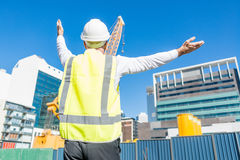 Senior foreman in glasses doing his job at building area on sunny day Stock Image