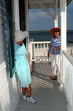 Senior friends at beach house. Senior women on a porch by the beach Stock Images