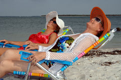 Senior friends beach vacation. Two senior women relaxing on the beach Royalty Free Stock Photography