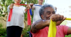 Senior friends exercising with resistance band 4k stock video